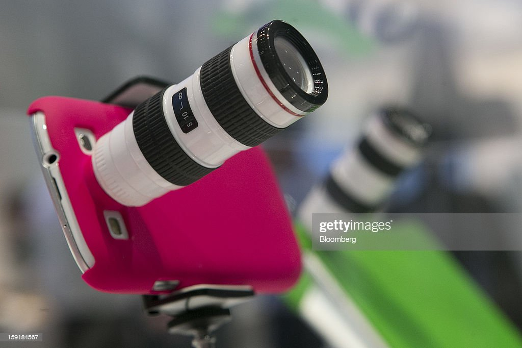 A Polaroid Corp. camera lens is attached to a Samsung Electronics Co. Galaxy S III smartphone during the 2013 Consumer Electronics Show in Las Vegas, Nevada, U.S., on Wednesday, Jan. 9, 2013. Samsung Electronics Co., the world's second-largest semiconductor maker, showed off a speedier and more powerful processor, seeking a bigger stake of the surging smartphone market. Photographer: Andrew Harrer/Bloomberg via Getty Images