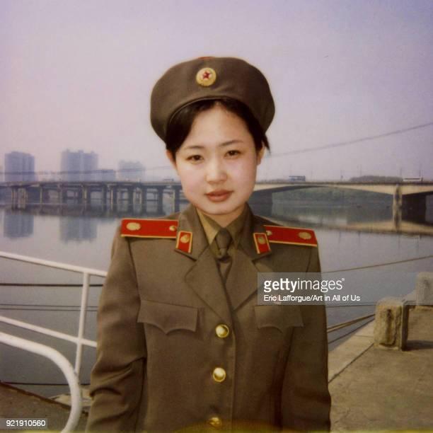 Polaroid of a North Korean guide called Kim at the victorious fatherland liberation war museum Pyongan Province Pyongyang North Korea on May 17 2005...