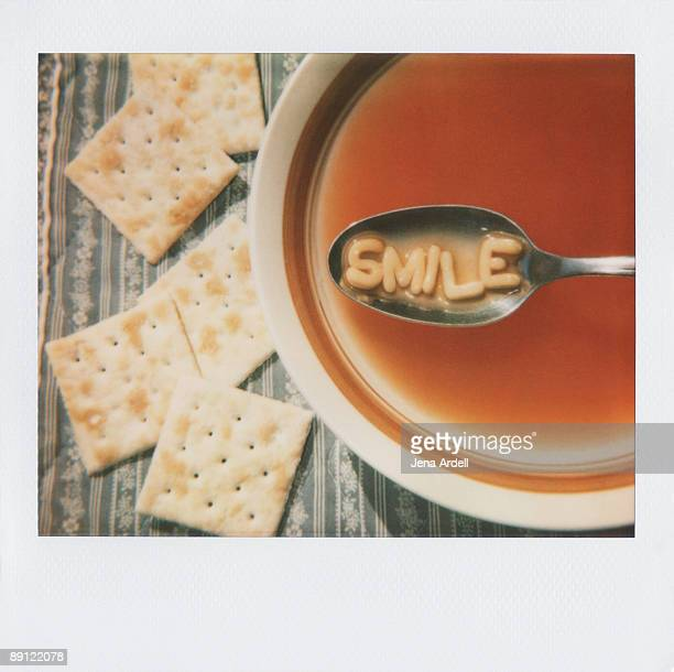 Polaroid of Alphabet Soup Letters Spelling Smile