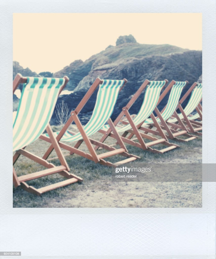 Polaroid Of Green And White Striped Deck Chairs Stock Photo