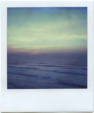 Polaroid of waves at sunset - gettyimageskorea