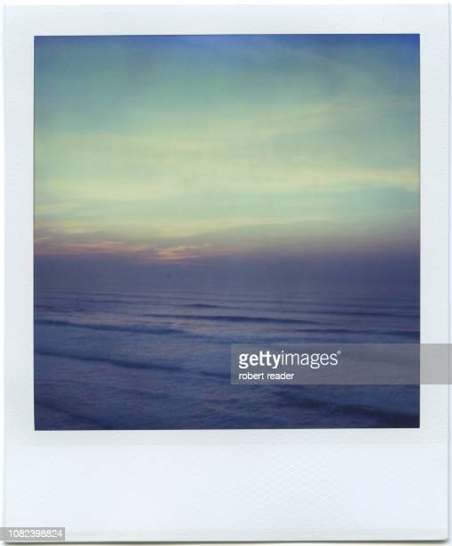 polaroid of waves at sunset - polaroid stock pictures, royalty-free photos & images