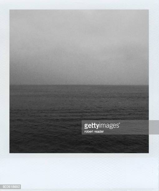 Polaroid photograph of calm sea