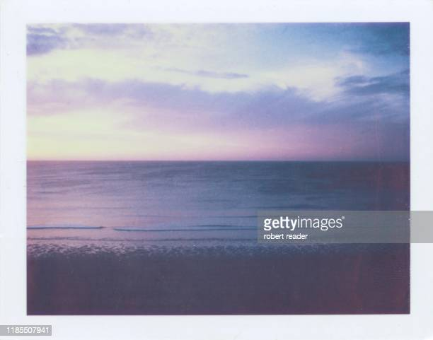 polaroid photograph of sunset over beach - memorial stock pictures, royalty-free photos & images