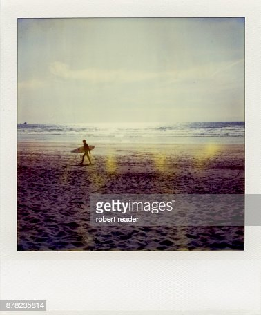 Polaroid photograph of surfer holding surf board