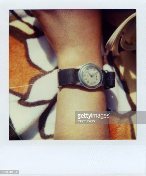 Polaroid photograph of watch on wrist