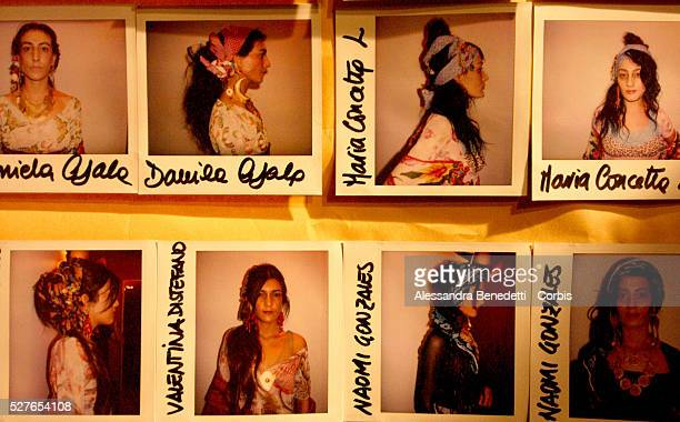 Polaroid photos of models hang on a backstage wall at the first fashion show entirely created by Rom tailors at the Macro Museum of Modern Art of Rome