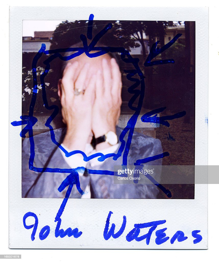 Polaroids -- -- John Waters poses for a photograph at the Toronto International Film Festival. For the movie This Filthy World.