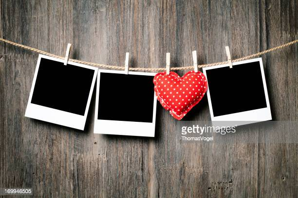 Polaroids and Heart on Clothesline