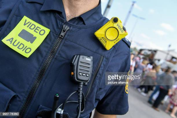 Polcie officer wearing a body camera can be seen at the Theresienwiese in Munich, Germany, 23 September 2017. This year's Oktoberfest festival will...