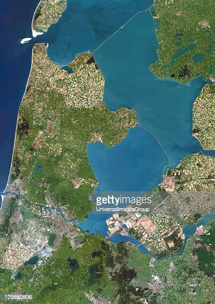 Polders in the Netherlands, true colour satellite image. Polders are land reclaimed from the sea, using dikes and dunes, that are drained to expand...
