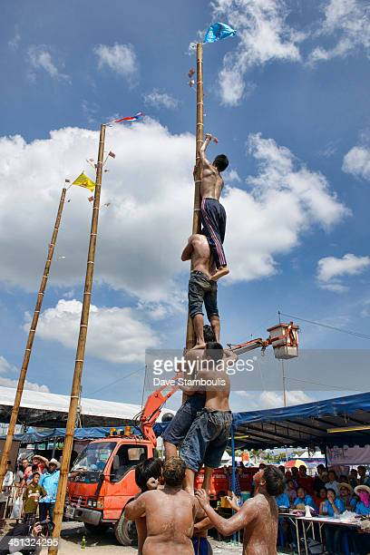 CONTENT] pole climbing boys at the Chonburi Buffalo Racing Festival Thailand