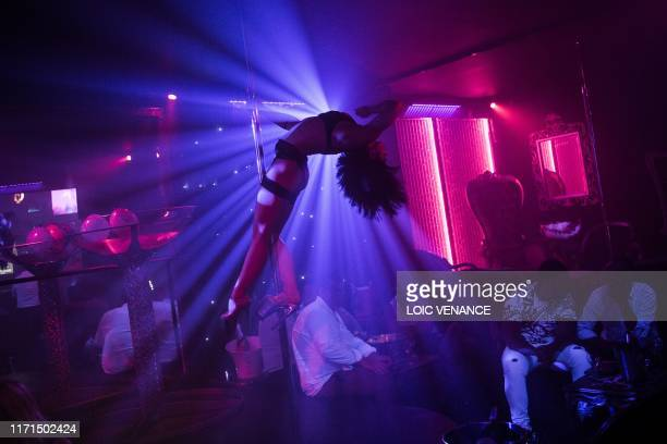 TOPSHOT A pole dancer performs at a pole dance club in Nantes western France on September 27 2019