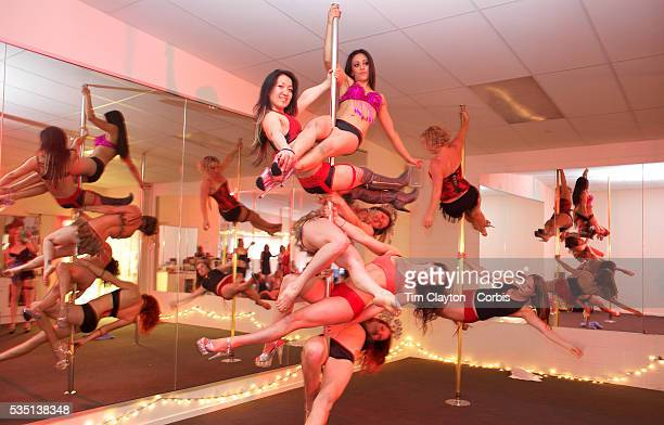 Pole dancers prepare for a photograph before Pole Dancing during the Queenstown Pole Studios end of year show at the Queenstown Pole Studio Gorge...