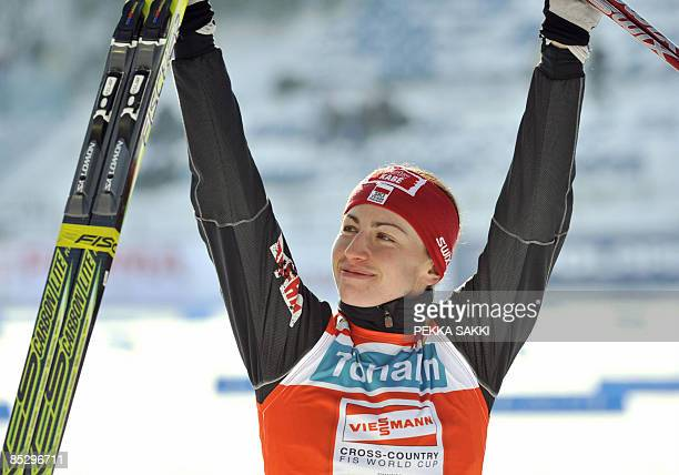 Pole Justyna Kowalczyk celebrates her victory in the women's 10km freestyle FIS nordic ski World Cup in Lahti on March 8 2009 Kowalczyk won ahead of...