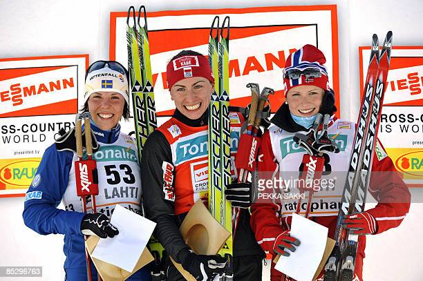 Pole Justyna Kowalczyk celebrates her victory on the podium with secondplaced Swede Charlotte Kalla and Norwegian Marthe Kristoffersen after the...