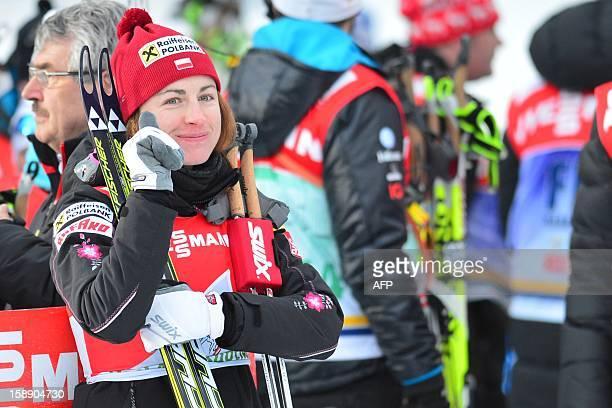 Pole Justyna Kowalczyk celebrates winning the women's Tour de Ski Stage four 15km free pursuit in Toblach on January 3 2013 Poland's Justyna...