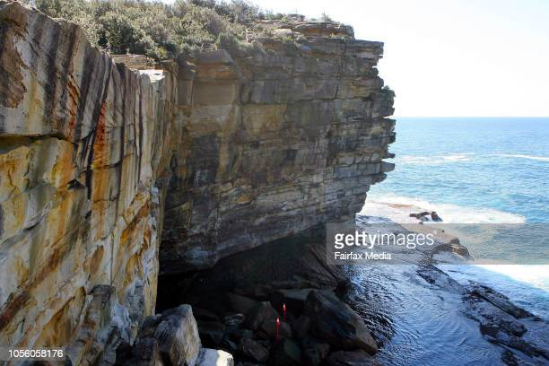 Pole markers at the bottom of a Sydney cliff where a model was allegedly thrown to her death by her boyfriend. Gordon Wood has pleaded not guilty to...