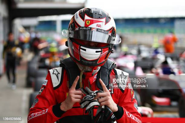 Pole position qualifier Callum Ilott of Great Britain and UNI-Virtuosi Racing celebrates in parc ferme during qualifying for the Formula 2...