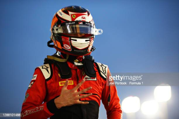 Pole position qualifier Callum Ilott of Great Britain and UNI-Virtuosi Racing celebrates in parc ferme during qualifying ahead of Round 11:Sakhir of...