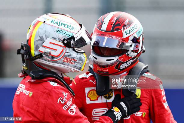 Pole position qualifier Charles Leclerc of Monaco and Ferrari and second place qualifier Sebastian Vettel of Germany and Ferrari celebrate in parc...