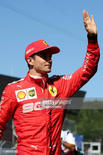 Pole position qualifier Charles Leclerc of Monaco and Ferrari celebrates in parc ferme during qualifying for the F1 Grand Prix of Austria at Red Bull...