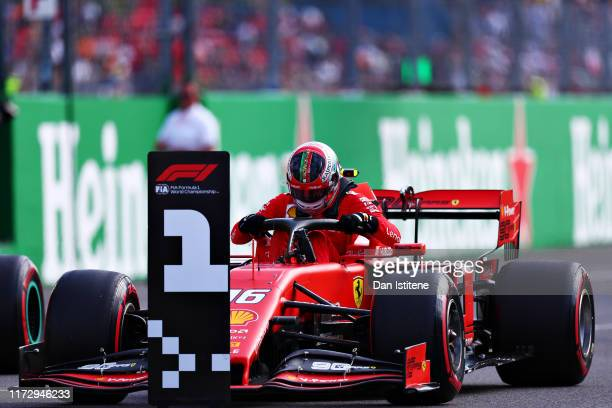 Pole position qualifier Charles Leclerc of Monaco and Ferrari celebrates in parc ferme during qualifying for the F1 Grand Prix of Italy at Autodromo...