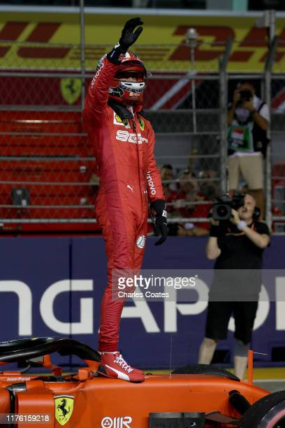 Pole position qualifier Charles Leclerc of Monaco and Ferrari celebrates in parc ferme during qualifying for the F1 Grand Prix of Singapore at Marina...