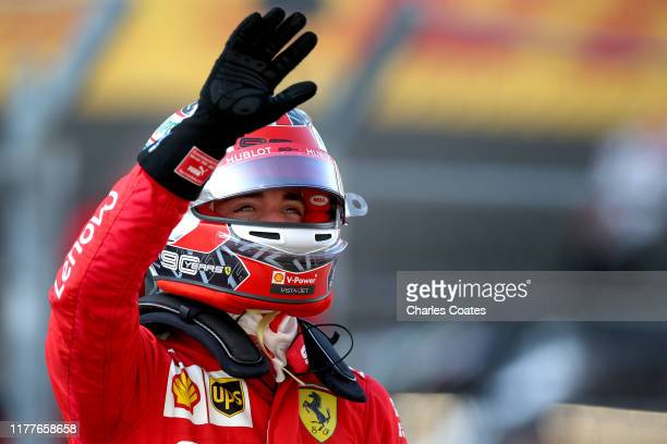 Pole position qualifier Charles Leclerc of Monaco and Ferrari celebrates in parc ferme during qualifying for the F1 Grand Prix of Russia at Sochi...