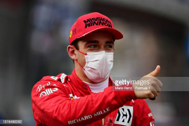 Pole position qualifier Charles Leclerc of Monaco and Ferrari celebrates in parc ferme during qualifying prior to the F1 Grand Prix of Monaco at...