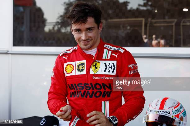 Pole position qualifier Charles Leclerc of Monaco and Ferrari celebrates in parc ferme during qualifying ahead of the F1 Grand Prix of Azerbaijan at...