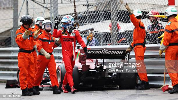 Pole position qualifier Charles Leclerc of Monaco and Ferrari waves to the crowd after crashing during qualifying for the F1 Grand Prix of Monaco at...
