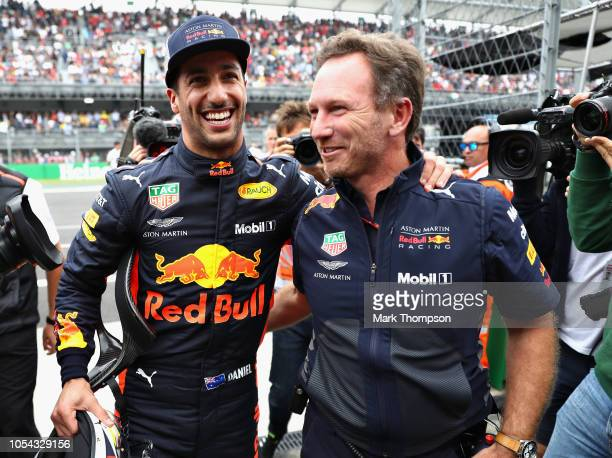 Pole position qualifier Daniel Ricciardo of Australia and Red Bull Racing celebrates with Red Bull Racing Team Principal Christian Horner in parc...