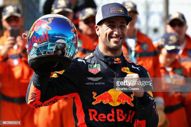 Pole position qualifier Daniel Ricciardo of Australia and Red Bull Racing celebrates in parc ferme during qualifying for the Monaco Formula One Grand...