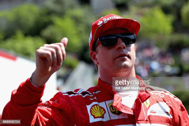 Pole position qualifier Kimi Raikkonen of Finland and Ferrari gives the fans a thumbs up in parc ferme during qualifying for the Monaco Formula One...