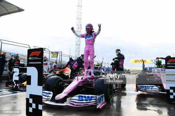 Pole position qualifier Lance Stroll of Canada and Racing Point celebrates in parc ferme during qualifying ahead of the F1 Grand Prix of Turkey at...