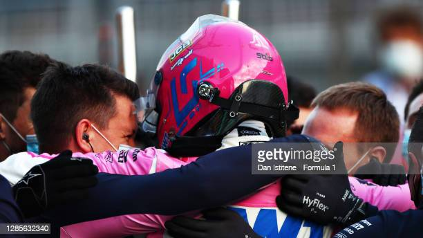 Pole position qualifier Lance Stroll of Canada and Racing Point celebrates with his in parc ferme during qualifying ahead of the F1 Grand Prix of...