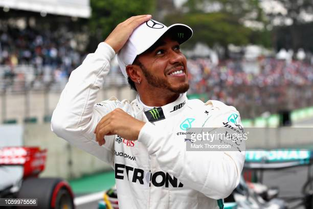 Pole position qualifier Lewis Hamilton of Great Britain and Mercedes GP celebrates in parc ferme during qualifying for the Formula One Grand Prix of...