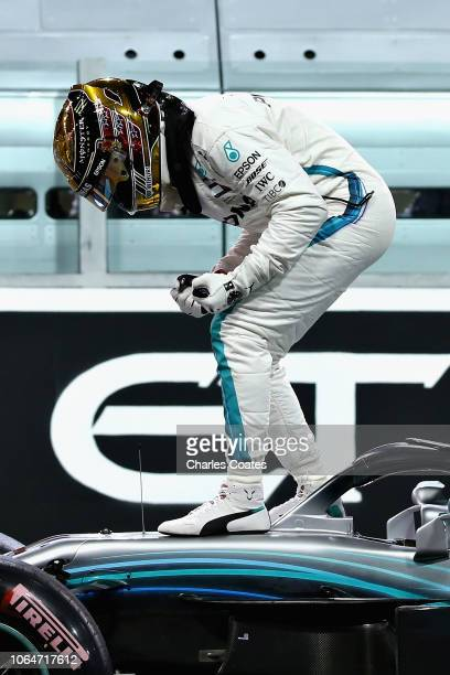 Pole position qualifier Lewis Hamilton of Great Britain and Mercedes GP celebrates in parc ferme during qualifying for the Abu Dhabi Formula One...