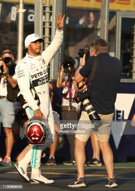 Pole position qualifier Lewis Hamilton of Great Britain and Mercedes GP celebrates in parc ferme during qualifying for the F1 Grand Prix of Australia...