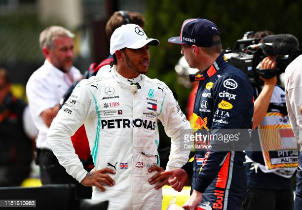 Pole position qualifier Lewis Hamilton of Great Britain and Mercedes GP celebrates in parc ferme during qualifying for the F1 Grand Prix of Monaco at...