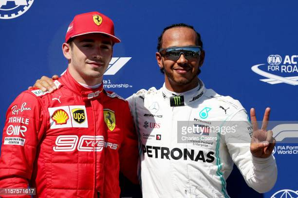 Pole position qualifier Lewis Hamilton of Great Britain and Mercedes GP celebrates with third place qualifier Charles Leclerc of Monaco and Ferrari...