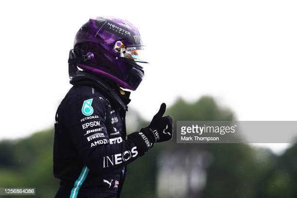 Pole position qualifier Lewis Hamilton of Great Britain and Mercedes GP celebrates in parc ferme during qualifying for the F1 Grand Prix of Hungary...