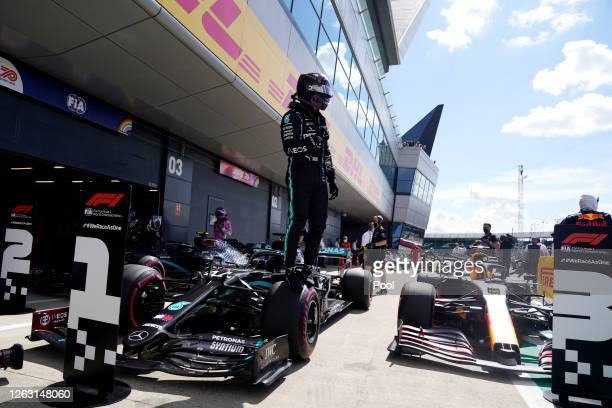 Pole position qualifier Lewis Hamilton of Great Britain and Mercedes GP celebrates in parc ferme during qualifying for the F1 Grand Prix of Great...