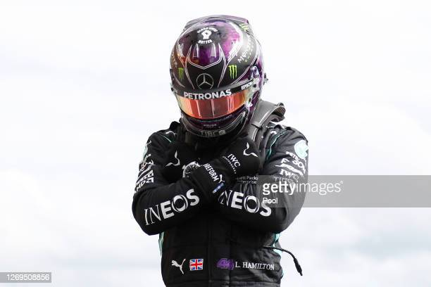 Pole position qualifier Lewis Hamilton of Great Britain and Mercedes GP celebrates in parc ferme during qualifying for the F1 Grand Prix of Belgium...