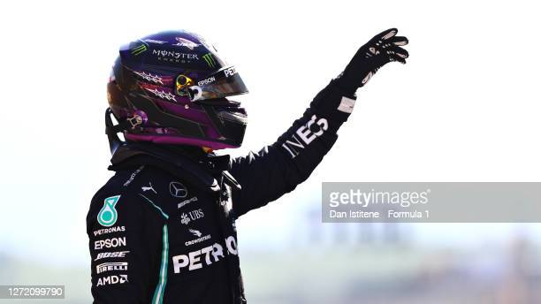Pole position qualifier Lewis Hamilton of Great Britain and Mercedes GP celebrates in parc ferme during qualifying for the F1 Grand Prix of Tuscany...