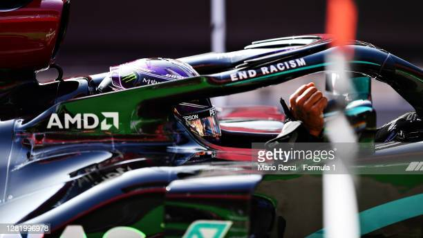 Pole position qualifier Lewis Hamilton of Great Britain and Mercedes GP stops in parc ferme during qualifying ahead of the F1 Grand Prix of Portugal...