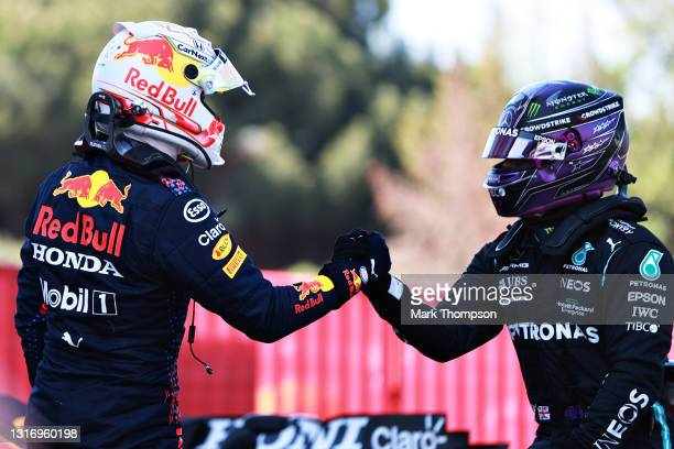 Pole position qualifier Lewis Hamilton of Great Britain and Mercedes GP shakes hands with second place qualifier Max Verstappen of Netherlands and...