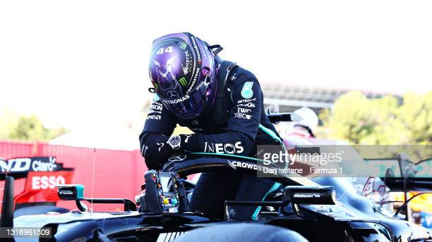 Pole position qualifier Lewis Hamilton of Great Britain and Mercedes GP celebrates in parc ferme during qualifying for the F1 Grand Prix of Spain at...