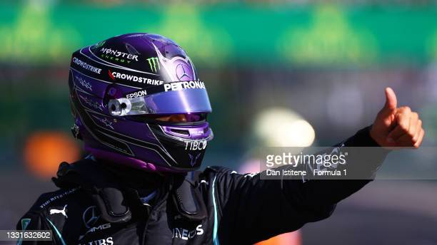 Pole position qualifier Lewis Hamilton of Great Britain and Mercedes GP celebrates in parc ferme during qualifying ahead of the F1 Grand Prix of...